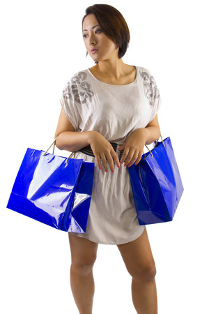 young asian female posing with shopping bags  photo