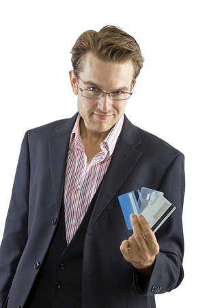 young male shopper posing with credit cards