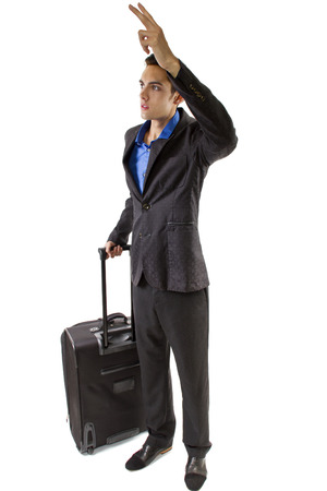 young caucasian businessman traveller gesturing for a cab photo