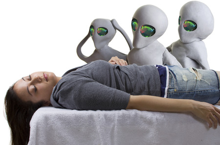 x files: young woman is the victim of an alien abduction Stock Photo