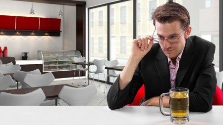 young businessman having beer at his lunch break Stock Photo - 24108684