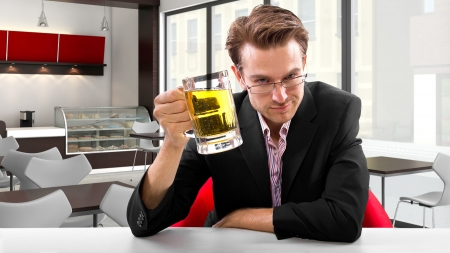 young businessman having beer at his lunch break Stock Photo - 24108685