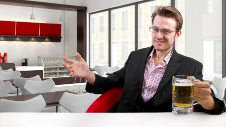 young businessman having beer at his lunch break Stock Photo - 24108686
