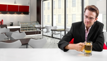 young businessman having beer at his lunch break Stock Photo - 24108687