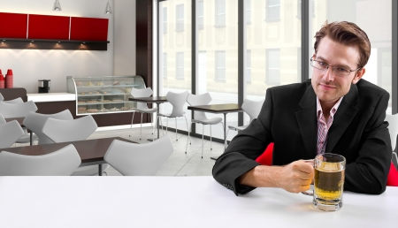 young businessman having beer at his lunch break Stock Photo - 24108689