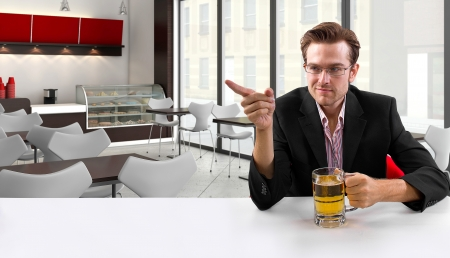 young businessman having beer at his lunch break Stock Photo - 24108698