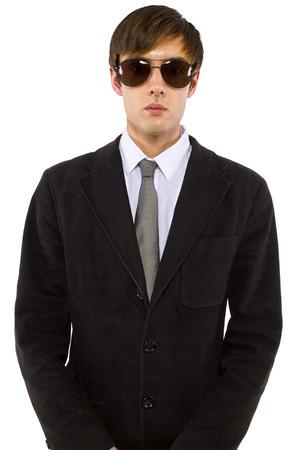 Caucasian male bodyguard wearing sunglasses and black suit Stock fotó