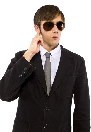 Caucasian male bodyguard wearing sunglasses and black suit Stock Photo