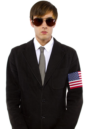 American spy waring a black suit and american flag armband photo