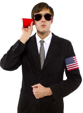 govt: American spy wearing black suit and holding a cup