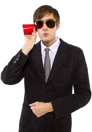 American spy wearing black suit and holding a cup photo