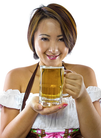young asian female waitress dressed in octoberfest costume photo