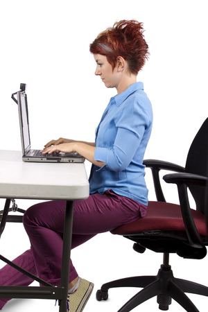 young woman demonstrating office desk posture photo