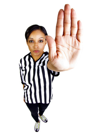 young black female referee with hand gestures photo