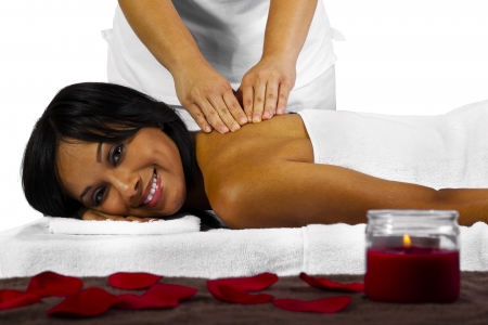 young black woman getting a back massage photo