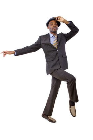young black businessman in a suit dancing  photo