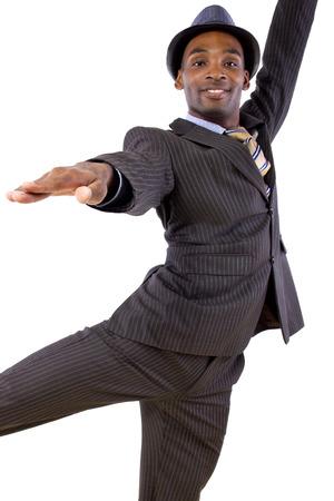 ballet dancing: young black businessman in a suit dancing