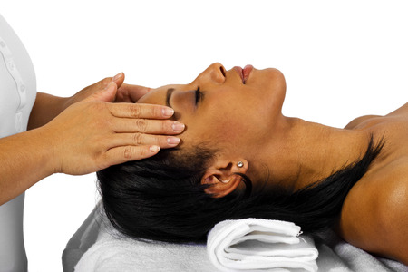 body massage: young black female getting a head massage   facial  Stock Photo