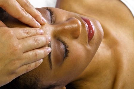 young black female getting a head massage   facial  photo