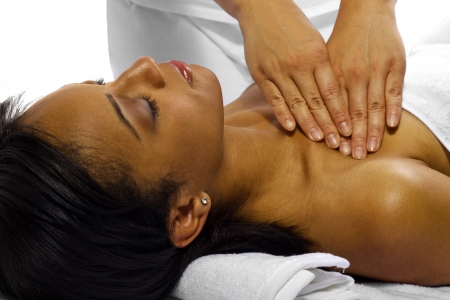 therapist masseuse treating a young black female client Фото со стока - 24609915