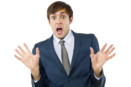trolling: young businessman with mocking gesture on white background