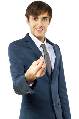 Businessman in a suit gesturing to collect money photo