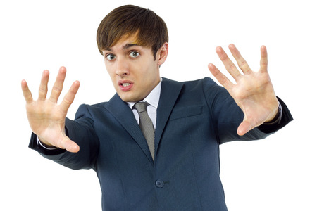 young businessman holding up his hand to viewer