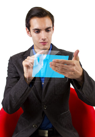 young male browsing on a hi-tech tablet photo