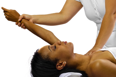 therapist masseuse treating a young black female client photo