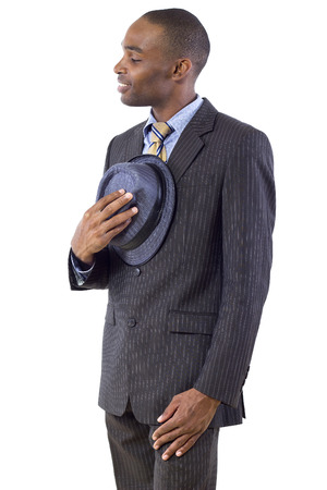 courteous: young black businessman being polite by taking hat off