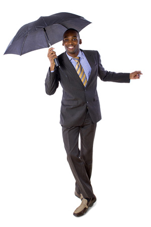 young black businessman dancing with an umbrella photo