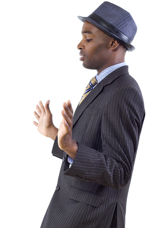 white backing: young black businessman in a retreating or defensive gesture