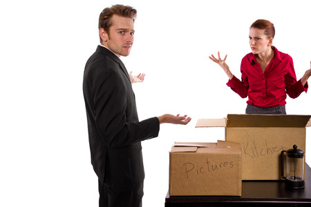 bitchy: young caucasian couple breaking up and moving out Stock Photo