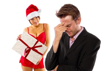 girlfriend seducing broke or stressed boyfriend on christmas photo