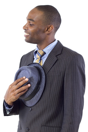 formalities: young black businessman being polite by taking hat off