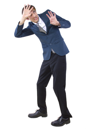 businessman in defensive pose danger from above Stock Photo