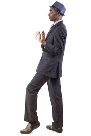 stepping: young black businessman in a retreating or defensive gesture