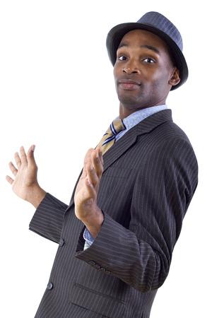 védekező: fiatal fekete üzletember egy visszavonuló vagy védekező gesztusa Stock fotó