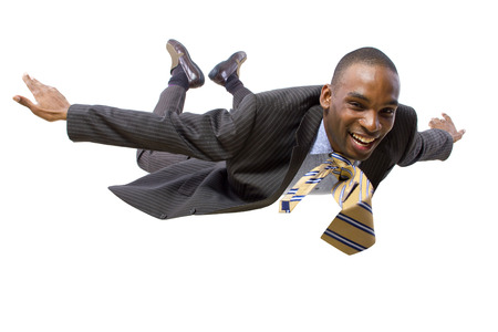 taking a risk: young african american businessman flying or skydiving