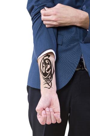 young caucasian businessman revealing a hidden tattoo photo