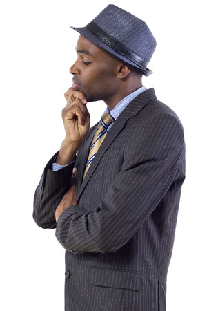 young black businessman looking down and contemplating photo