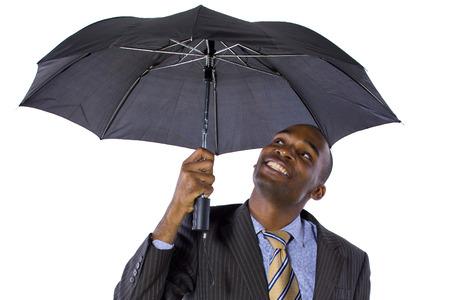 young black businessman looking confident under an umbrella photo
