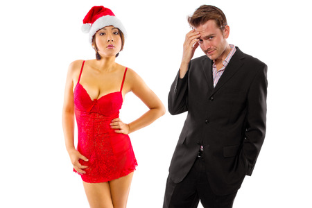 girlfriend seducing broke or stressed boyfriend on christmas photo