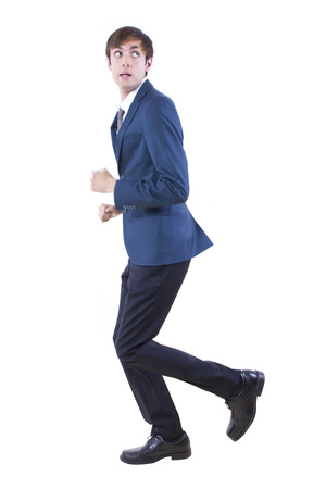 young caucasian businessman running away from imaginary threat