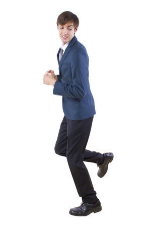 escaping: young caucasian businessman running away from imaginary threat