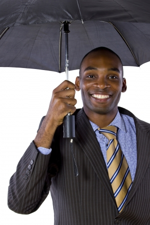 young black businessman looking confident under an umbrella photo