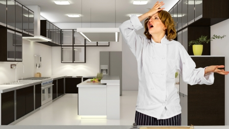 Stressed out female chef in a commercial kitchen photo