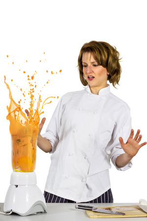 young female chef forgot to put the lid Stockfoto