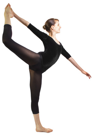 young female ballet dancer posing with a yoga pose