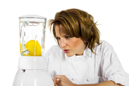 chef using a blender to make fruit juice photo